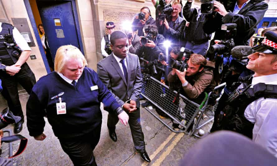 Kweku Adoboli leaves City of London magistrates court, in central London, on 22 September  2011