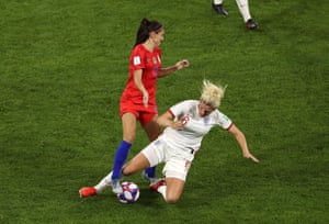 Millie Bright of England fouls Alex Morgan of the USA, leading to a second yellow, and therefore a red card.