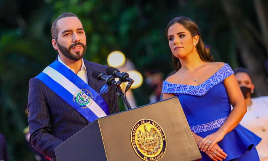 El Salvador's President Nayib Bukele with a woman to his left