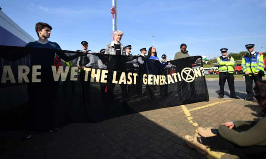Young climate activists demonstrate at Heathrow as part of the Extinction Rebellion protests.