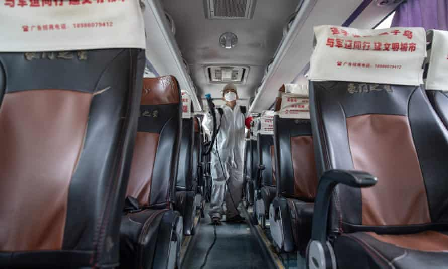 Disinfectant is sprayed on a bus in Wuhan, Hubei