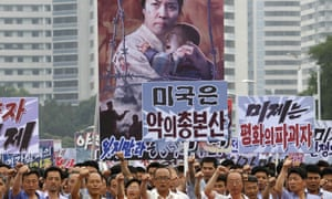 Thousands of men and women carry placards with anti-American propaganda during a rally in Pyongyang in 2017.