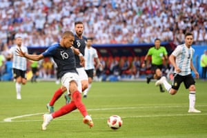Mbappe of France scores his team's fourth goal.