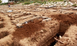 A man digs a grave at a cemetery where victims of Covid-19 are buried in Taiz, Yemen