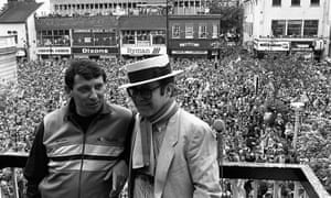 Graham Taylor and Elton John on a balcony overlooking celebrating Watford fans in May 1984.