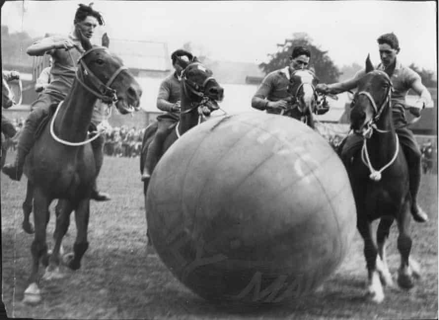 Artillerymen enjoy a game of pushball on horseback at the 1927 Leek Carnival in Staffordshire.