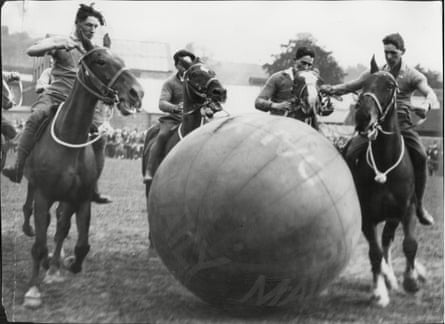 Artillerymen enjoy a game of pushball on horseback at the 1927 Leek Carnival in Staffordshire.