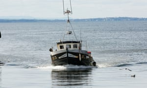 A fishing boat in the harbour at Buckie in Scotland.