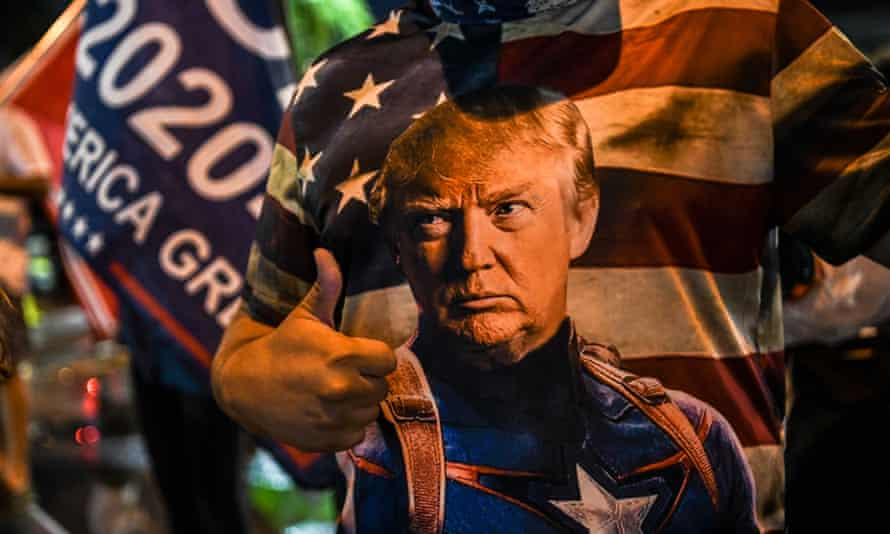 A Trump supporter wears a T-shirt depicting the US president as Captain America, in Miami, Florida, 5 November 2020.