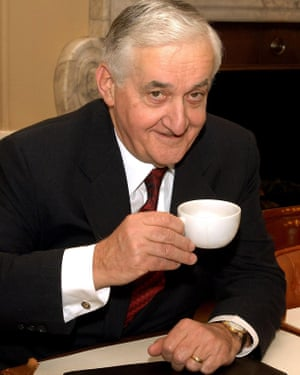 Doug Oakervee, the chair of the inquiry into the HS2 rail network, with a teacup in one hand