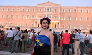 Rising stars: a pro-European Union protester wearing an EU flag stands in front of the Greek parliament in Athens.