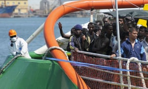 Refugees look out from the Bourbon Argos as it approaches the Italian island of Sicily.