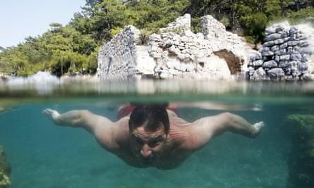 According to Plato: 'A man is not learned until he can read, write, and swim.' In the water at Hamam Koyu, a former Roman bath in Mugla, Turkey.