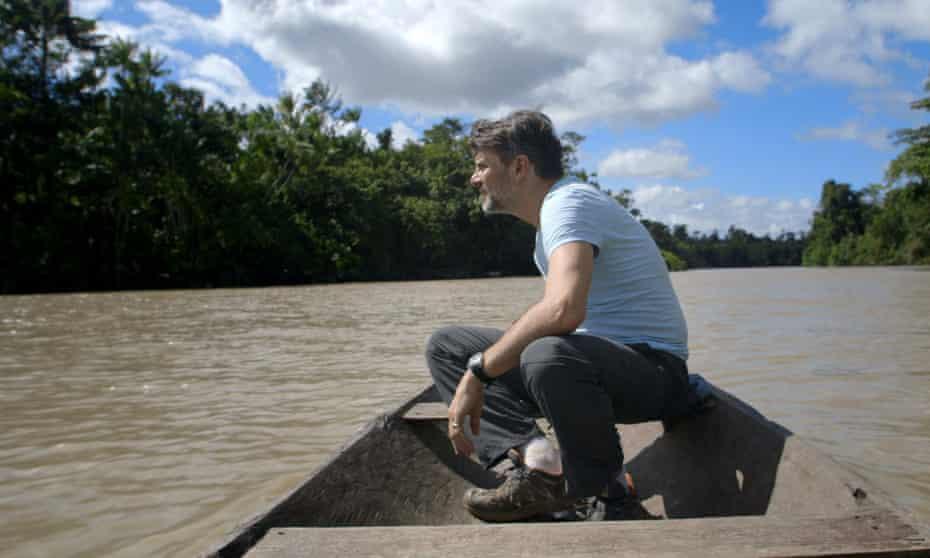 Jeremy Schwartz crossing a tributary of the Amazon in Brazil.