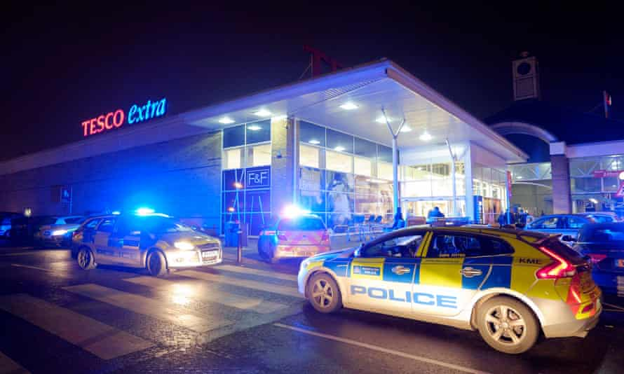 Police outside Lee Valley Tesco Extra in north London on Black Friday