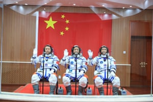 Astronauts Tang Hongbo, Nie Haisheng and Liu Boming attend a see-off ceremony