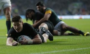 New Zealand's Beauden Barrett scores a try
