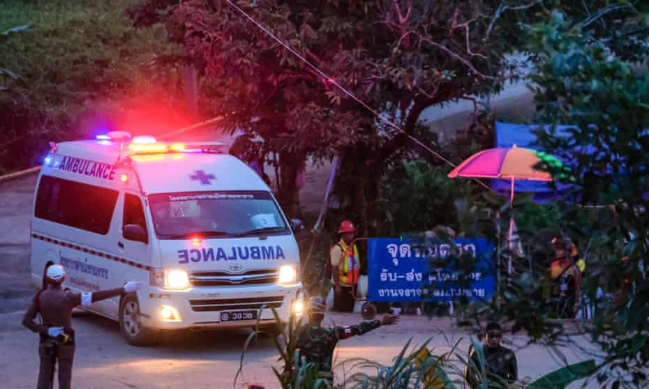 An ambulance carrying one of the rescued boys