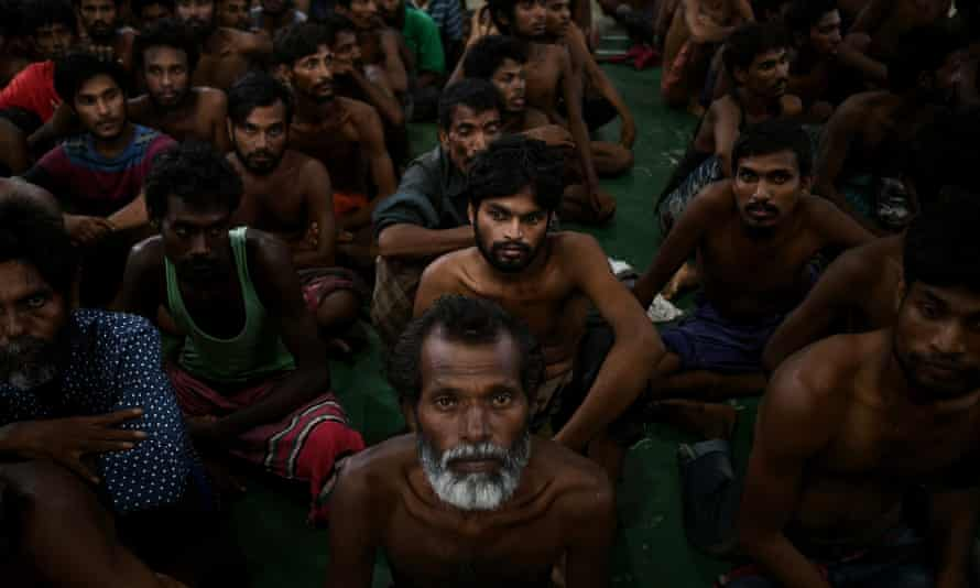 Illegal migrants wait at the police headquarters in Langkawi in May 2015, after landing on Malaysian shores. Malaysia has been upgraded from the list of worst offenders in the 2015 Trafficking in Persons report.