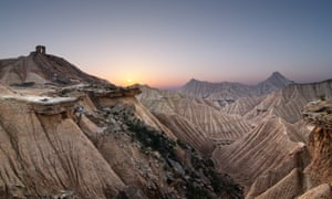 The sunset amid the mountainous and desert-like landscape at Bardenas Reales natural park in Navarra, northern Spain
