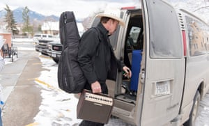 Democrat Rob Quist loads his guitar and amp into his van after a campaign stop in Livingston, Montana.