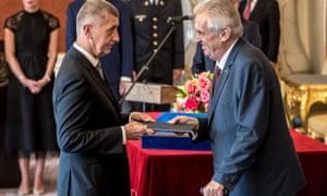 Andrej Babiš, left, receives documents from Miloš Zeman, the populist Czech president, in Prague