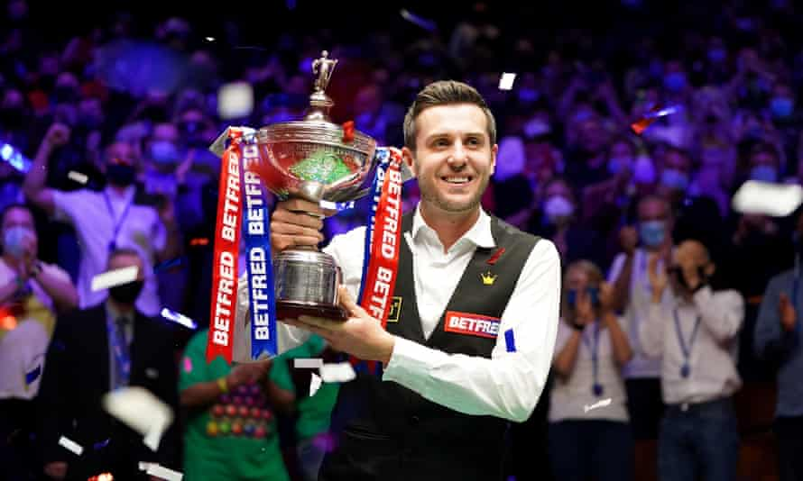 Mark Selby grasps the trophy after adding the 2021 world snooker title to his 2014, 2016 and 2017 victories at the Crucible.
