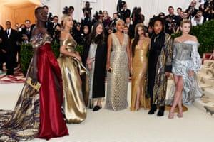 Fashion power squad Alek Wek, Jasmine Sanders, Valerie Messika, Kiersey Clemons, Olivia Munn, Luka Sabbat, and Lili Reinhart join forces on the Met Gala red carpet.