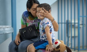 Shaina kisses her son Keydiel, five, in the yard of the school he attends in Yabucoa, Puerto Rico.