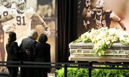 New Orleans Saints owner Tom Benson at Smith's casket during a visitation hosted at the team's indoor practice facility.