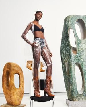 Model in front of Barbara Hepworth artworks at JW Anderson exhibition at Hepworth Wakefield