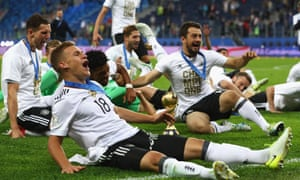 Chile v Germany: Final - FIFA Confederations Cup Russia 2017<br>SAINT PETERSBURG, RUSSIA - JULY 02:  Joshua Kimmich of Germany celebrates with the FIFA Confederations Cup trophy after the FIFA Confederations Cup Russia 2017 Final between Chile and Germany at Saint Petersburg Stadium on July 2, 2017 in Saint Petersburg, Russia.  (Photo by Alexander Hassenstein/Bongarts/Getty Images)