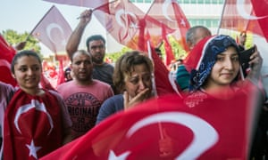 People celebrate at Ataturk airport in Istanbul after it was retaken from the military.