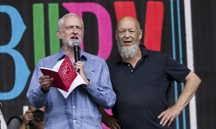 Labour leader Jeremy Corbyn at Glastonbury, joined by the festival's founder Michael Eavis