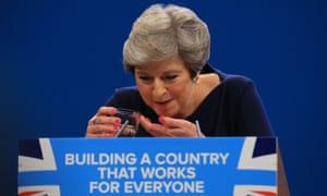 Theresa May splutters as she drinks water after losing her voice