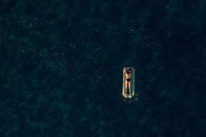 Ierapetra, Crete: an aerial view of a woman resting on an inflatable off the beach of Koutsounari