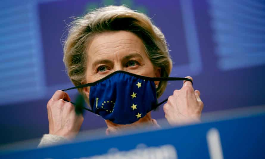 Ursula von der Leyen puts on an EU facemask after addressing a media conference on the Brexit negotiations