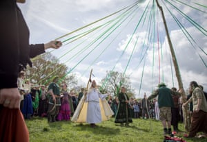 People dance around the maypole
