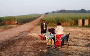 Inkatha Freedom party agents prepare a polling station in farm lands near Eshowe