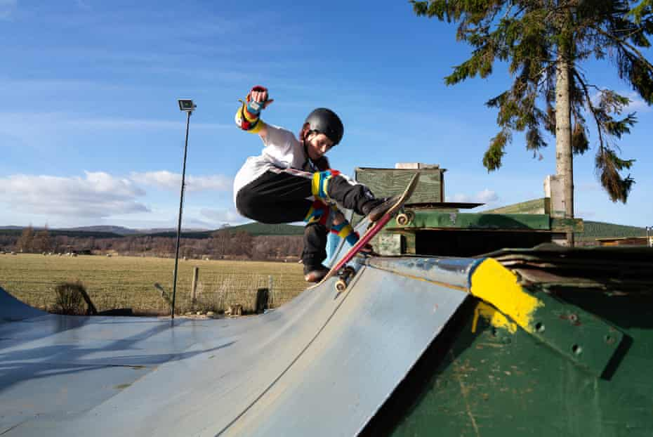 Scottish skateboarder, Emily Rothney, lands a frontside rock on her garden mini-ramp in Carrbridge, in the Highlands of Scotland. She skates here every day with her sister Rosie.
