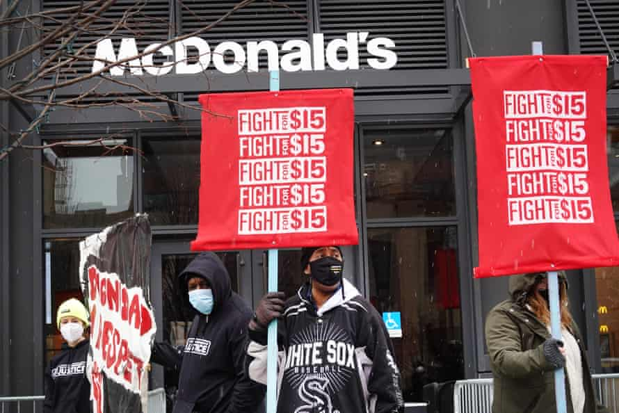 People take part in a demonstration to raise the minimum wage outside of McDonald's corporate headquarters in Chicago on 15 January.