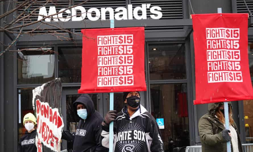 Demonstrators participate in a protest outside of McDonald's corporate headquarters in Chicago, Illinois