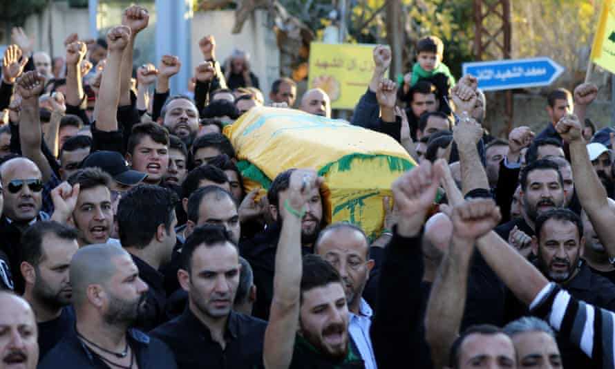 Mourners chant slogans as they carry Adel Termos's coffin