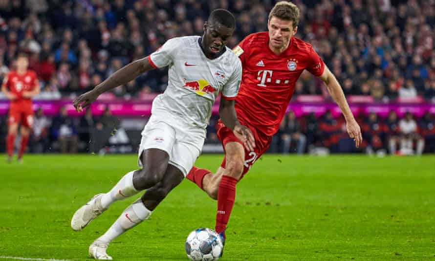Dayot Upamecano battles with Bayern Munich's Thomas Müller in February 2020.