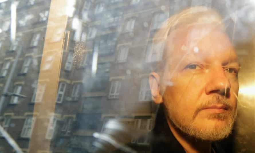 Julian Assange is taken from court in London in May 2019.