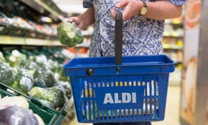 'Soldiering on': a shopper looks for good deals in a London branch of Aldi