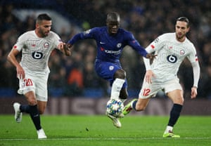 N'Golo Kante runs past Yusuf Yazci and Thiago Maia.