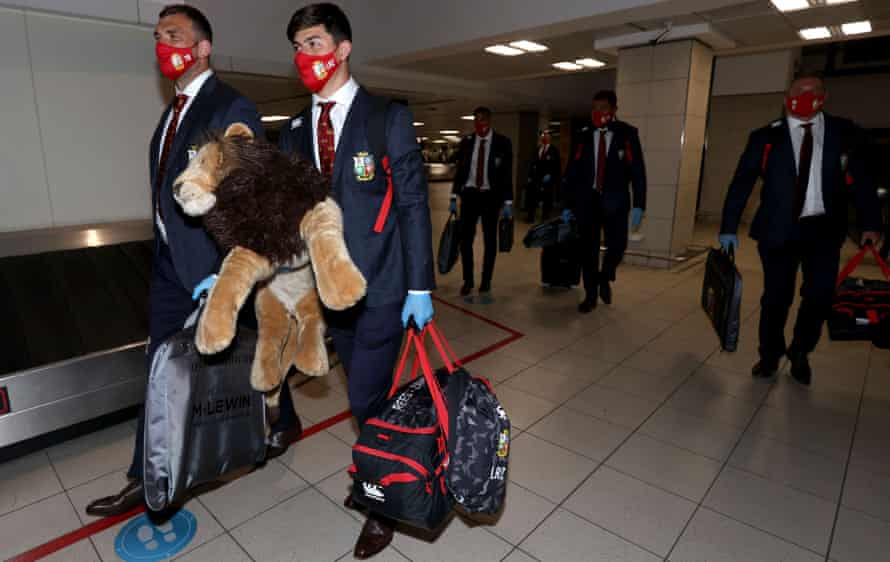 Louis Rees-Zammit arrives at Johannesburg airport with the Lions' mascot, BIL