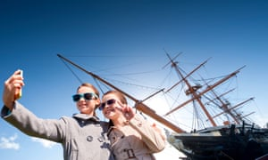 2. Portmouth Young visitors with HMS Warrior at Portsmouth Historic Dockyard Credit historicdockyard.co.uk