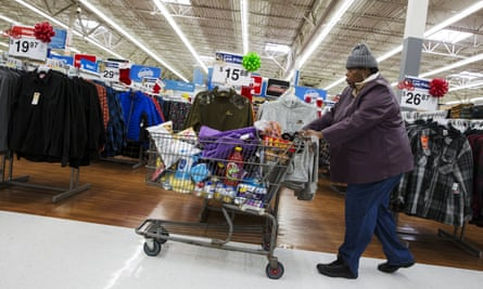 A woman pushes her shopping cart through a Walmart store in Secaucus, New Jersey, earlier this month.